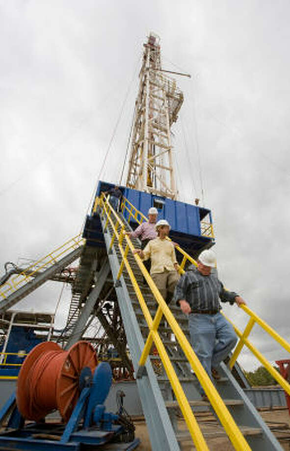 Descending from the rig, are, from bottom, Schultz, John Kyle and James Pitts. Photo: Steve Campbell, Houston Chronicle