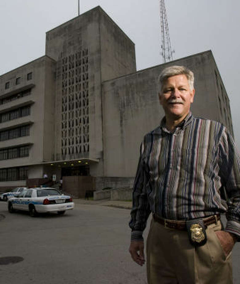 "Capt. Richard Holland, 52, is about to say goodbye to headquarters at 61 Riesner where he spent about 10 years of his career. He is retiring today from the Houston Police Department after 32 years on the force. He said of his experiences: ""I wouldn't trade a minute of it."" Photo: Johnny Hanson, Chronicle"