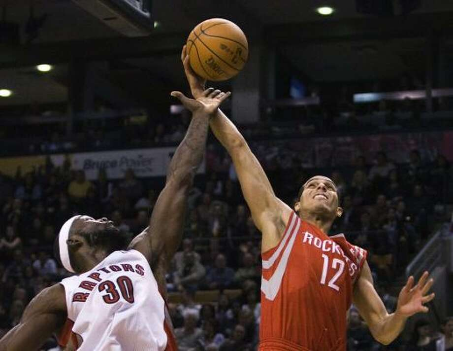 Rockets guard Kevin Martin, right, battles of the ball with Raptors forward Reggie Evans on Friday night. Photo: Nathan Denette, AP