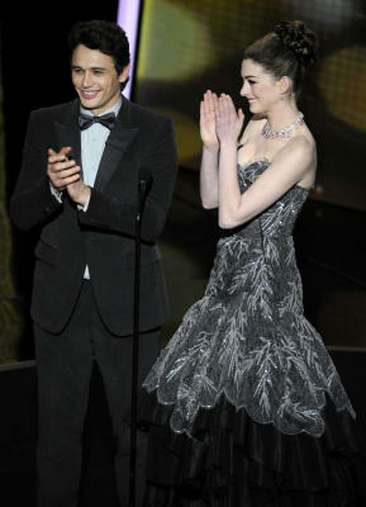 Show hosts James Franco, left, and Anne Hathaway are seen during the 83rd Academy Awards on Sunday, Feb. 27, 2011, in the Hollywood section of Los Angeles.