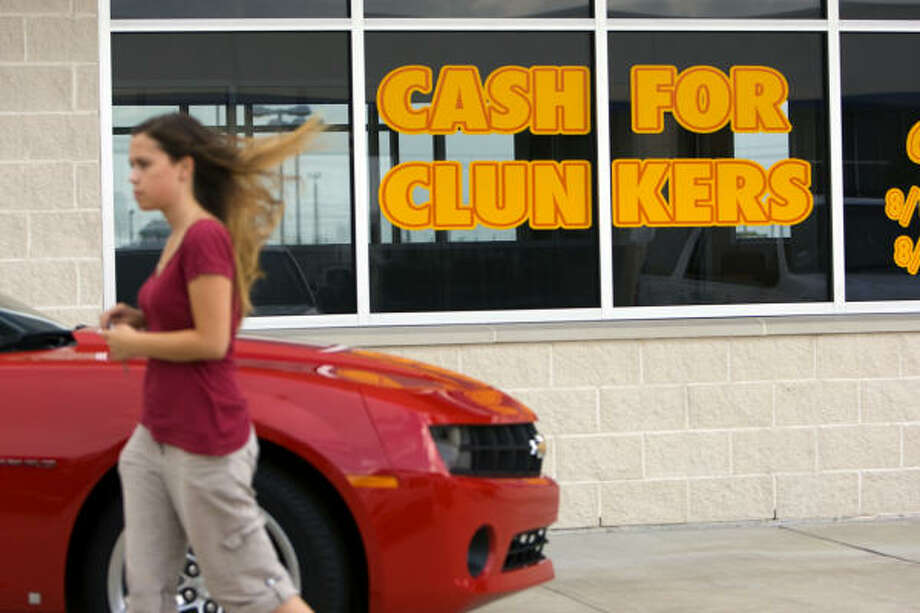 Merina Mesa, of Baytown, leaves the car showroom at Monument Chevrolet, where she was hoping to trade in her older vehicle for a newer one through the Cash for Clunkers program Monday in Pasadena. Photo: Johnny Hanson, Chronicle