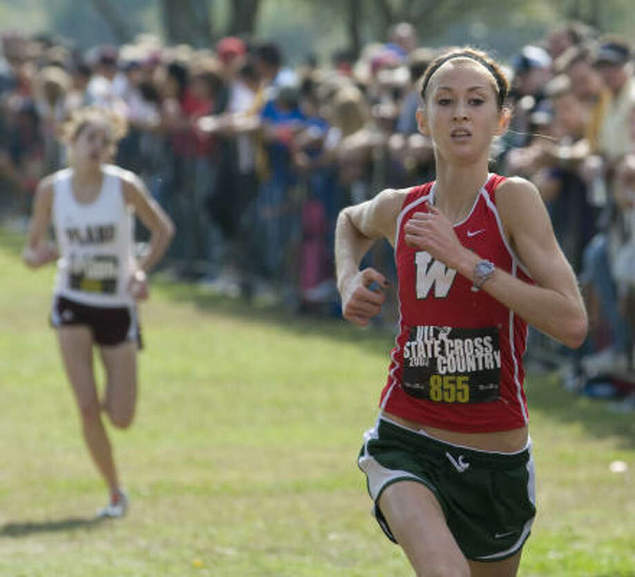 The Woodlands senior Sarah Andrews, who made a name for herself at the 2007 Class 5A state cross country meet, finished her high school cross country career by winning a second straight 5A state title. Photo: Andy Sharp, For The Chronicle