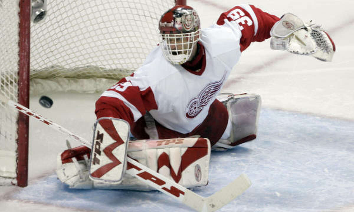 Dominik Hasek and the Detroit Red Wings are on to the Western Conference finals after defeating the Sharks.