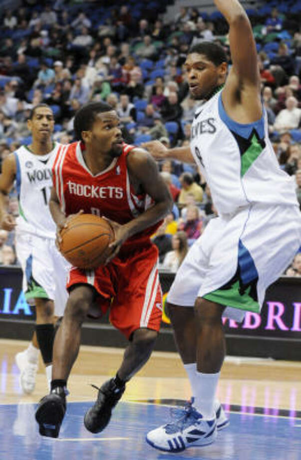 Aaron Brooks, left, struggled against the Bulls Saturday but bounced back against the T-Wolves Sunday. Photo: Jim Mone, AP