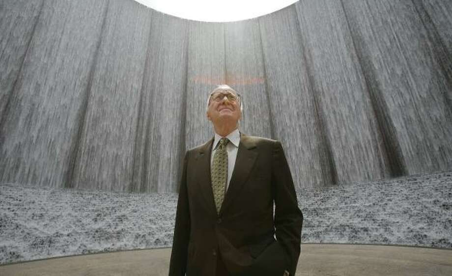 "Gerald Hines, by the water wall of the Williams Tower he developed, lives in London but considers Houston his hometown. ""Gerald Hines put us on the map in terms of great buildings,"" said Barrie Scardino, of the local chapter of the American Institute of Architects. Photo: STEVE CAMPBELL, CHRONICLE"