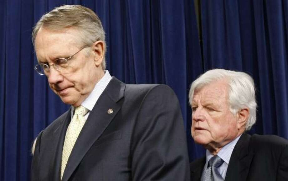 """Sen. Edward Kennedy, right, appearing at a news conference Thursday with Senate Majority Leader Harry Reid, said the immigration overhaul effort is not going away. """"We will be back,"""" he vowed. Photo: SUSAN WALSH, ASSOCIATED PRESS"""
