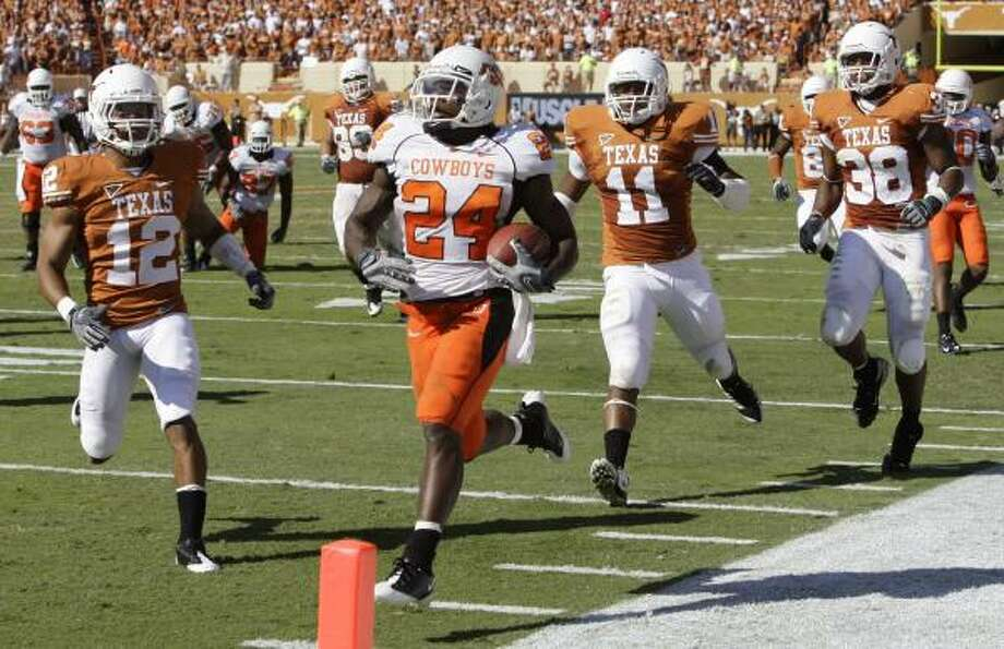UT defenders were playing catch-up all day long against shifty Oklahoma State running back Kendall Hunter. Photo: Eric Gay, Associated Press