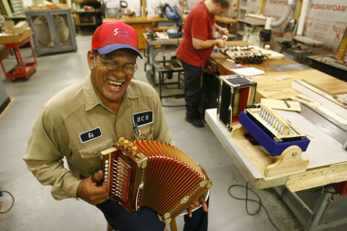 Ed Poullard cracks up as he plays a zydeco song on one of his Cajun accordions.