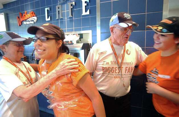 Whataburger's biggest fans Karl and Carol Hoepfner are greet by Whataburger  employees, Dana Sanchez and Kimberly Graham, Whataburger by The Bay on Shoreline blvd in Corpus Christi, Texas.  The Rockport couple share a passion that drove them to 225 Whataburger locations and will lead them to 497 more.  (AP Photo/Corpus Christi Caller-Time, George Gongora) Photo: George Gongora, MBO