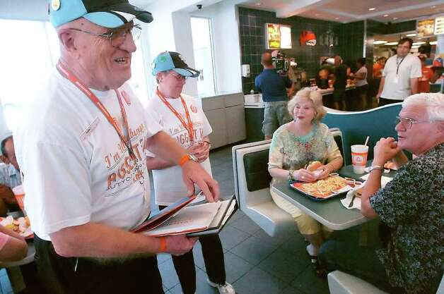 Whataburger bigger fans, Karl and Carol Hoepfner at left talk with customers at Whataburger on The Bay on Wednesday, July 20, 2011 in Corpus Christi, Texas.  The Rockport couple share a passion that drove them to 225 Whataburger locations and will lead them to 497 more.  (AP Photo/Corpus Christi Caller-Time, George Gongora) Photo: Geoerge Gongora, MBO