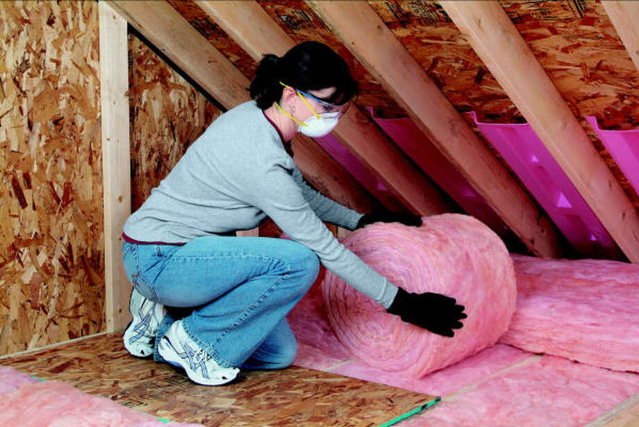 INSULATION PERSUASION:Installing roll insulation, usually made up of fiberglass or rock wool, is an easy do-it-yourself weekend job that saves you money.