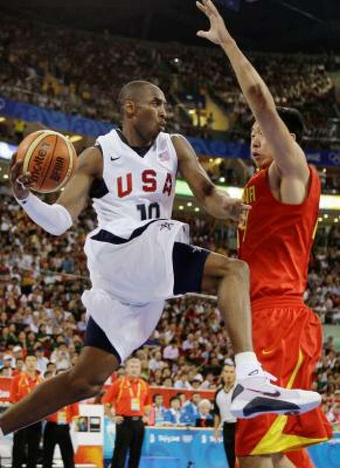 Kobe Bryant drives to the basket against China's Wang Zhizhi. Photo: Dusan Vranic, AP