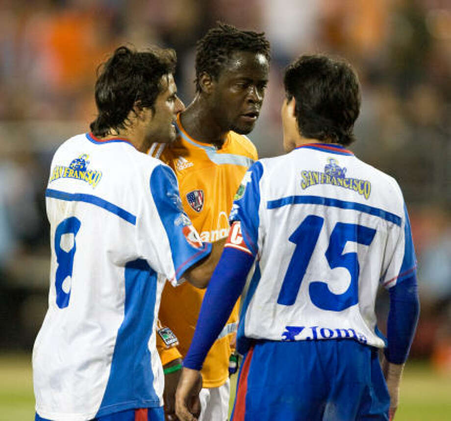 """Dynamo forward Kei Kamara, center, has been suspended for two games and fined $500 by MLS for """"inappropriate"""" comments to an official following a preseason match on Feb. 15. Photo: Bob Levey, For The Chronicle"""