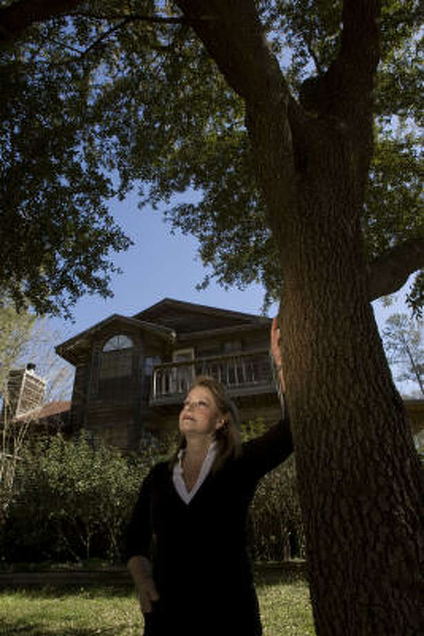 Janice Saunders is moving out of her dream home in Humble and leaving the live oak tree she planted because she says she has grown weary of worrying about flooding. Photo: Johnny Hanson, Chronicle