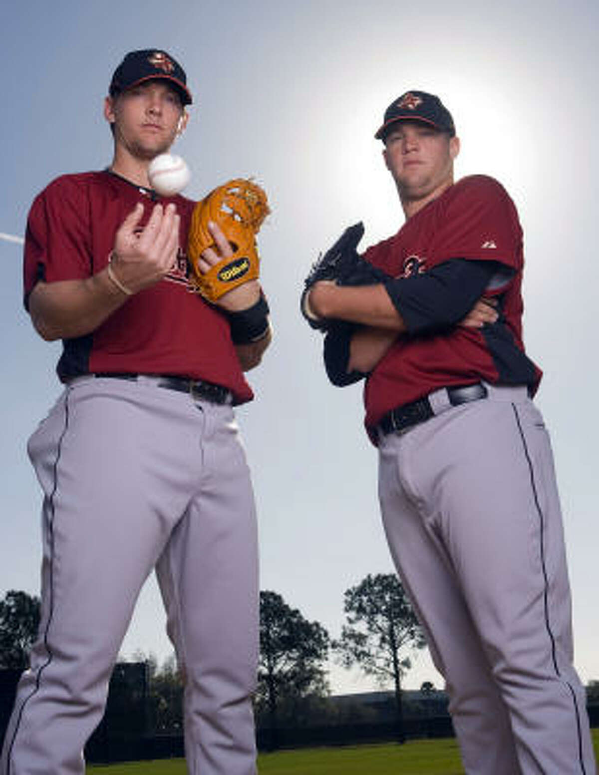Chris Johnson (left) and Bud Norris impressed general manager Ed Wade in their time in spring training.