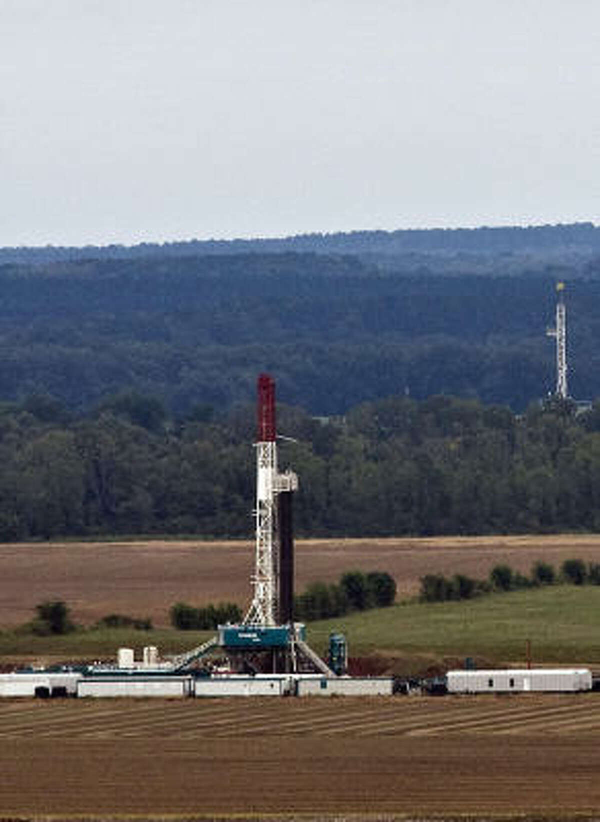 Drilling rigs dot northwest Louisiana, where locked into cement-like shale formations thousands of feet underground are potentially huge quantities of natural gas.
