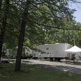 """Crew members work at parking lot that is part of the Stanford Heights Fire Department in Schenectady on Wednesday, July 27, 2011.  The parking lot was being used by the crew of the movie """"The Place Beyond the Pines""""  to work out of while filming was being done nearby.   (Paul Buckowski / Times Union)"""