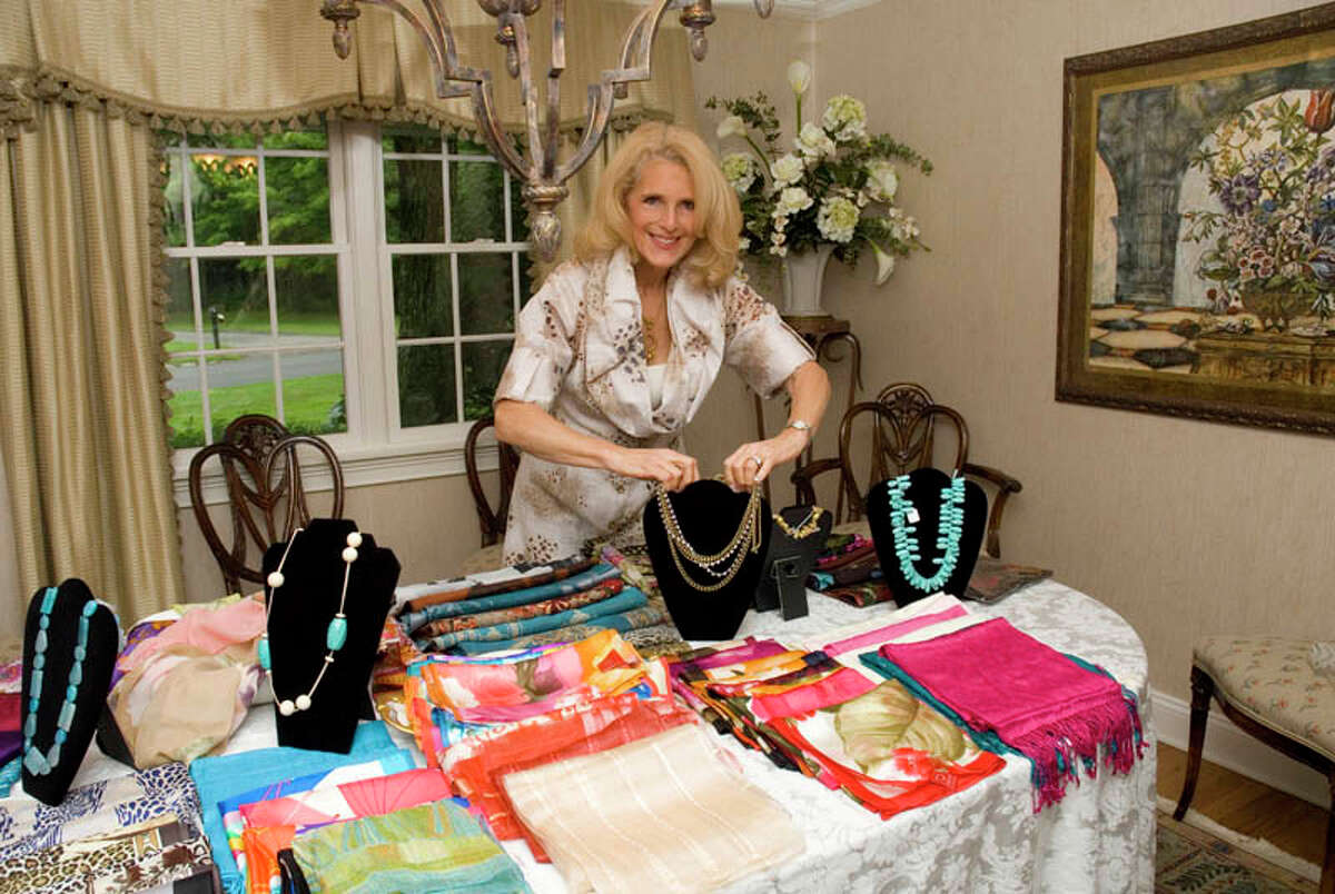Pam Friedlander, of Positive Reflections, displays a collection of accessories during a show to celebrate her fifth year in business.