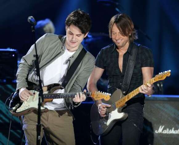 John Mayer, left, and Keith Urban team for a segment of CMT's Crossroads. Photo: M. Spencer Green, AP