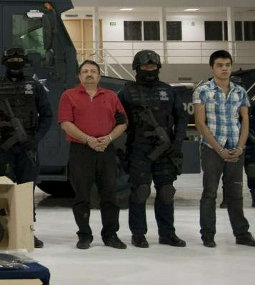 Members of the Sinaloa cartel are presented to the press in Mexico City on Nov. 8 following their arrests in Culiacan. Photo: RONALDO SCHEMIDT, AFP/Getty Images