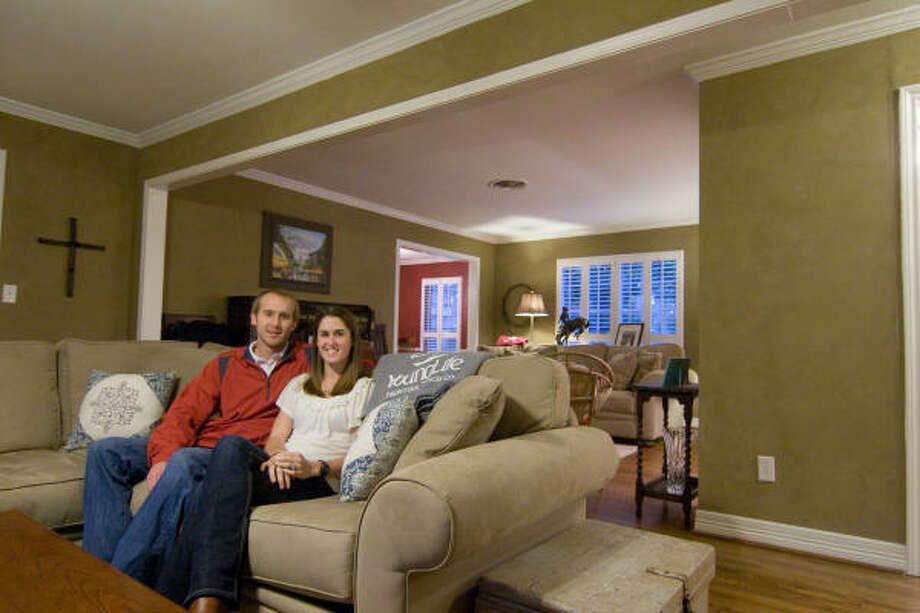 REMODELED: Sarah and Luke Allen recently took out a load-bearing wall in their living room to provide additional space for Young Life meetings. The renovation will be seen on the DIY Network. Photo: R. Clayton McKee, For The Chronicle