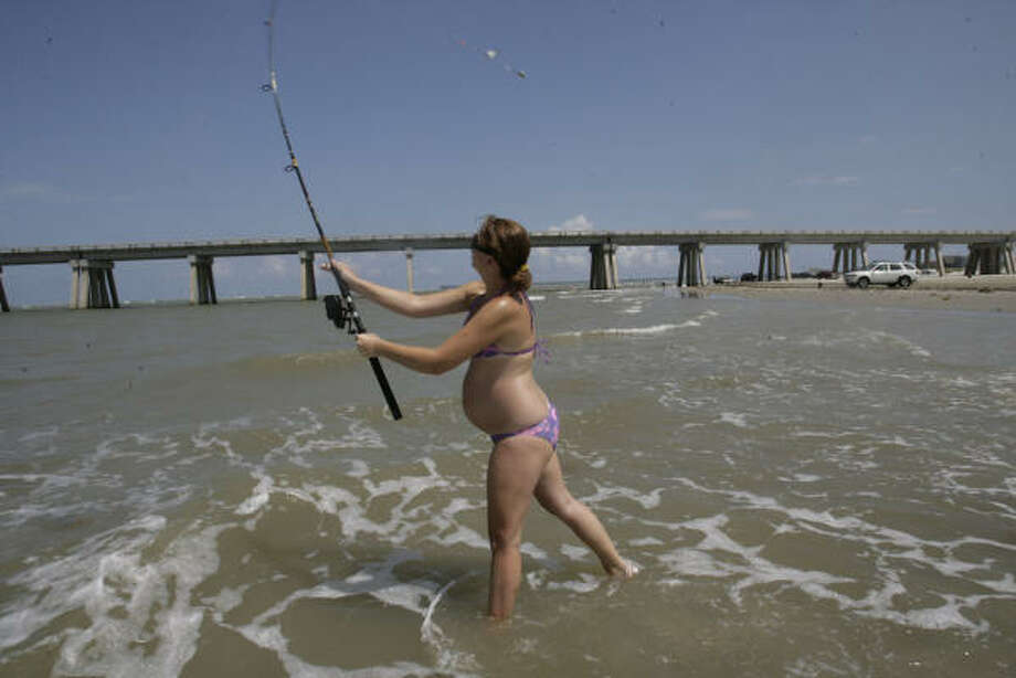 We'll miss...Catching our (free) dinner at some of our favorite beach-side spots. Photo: Julio Cortez, Chronicle