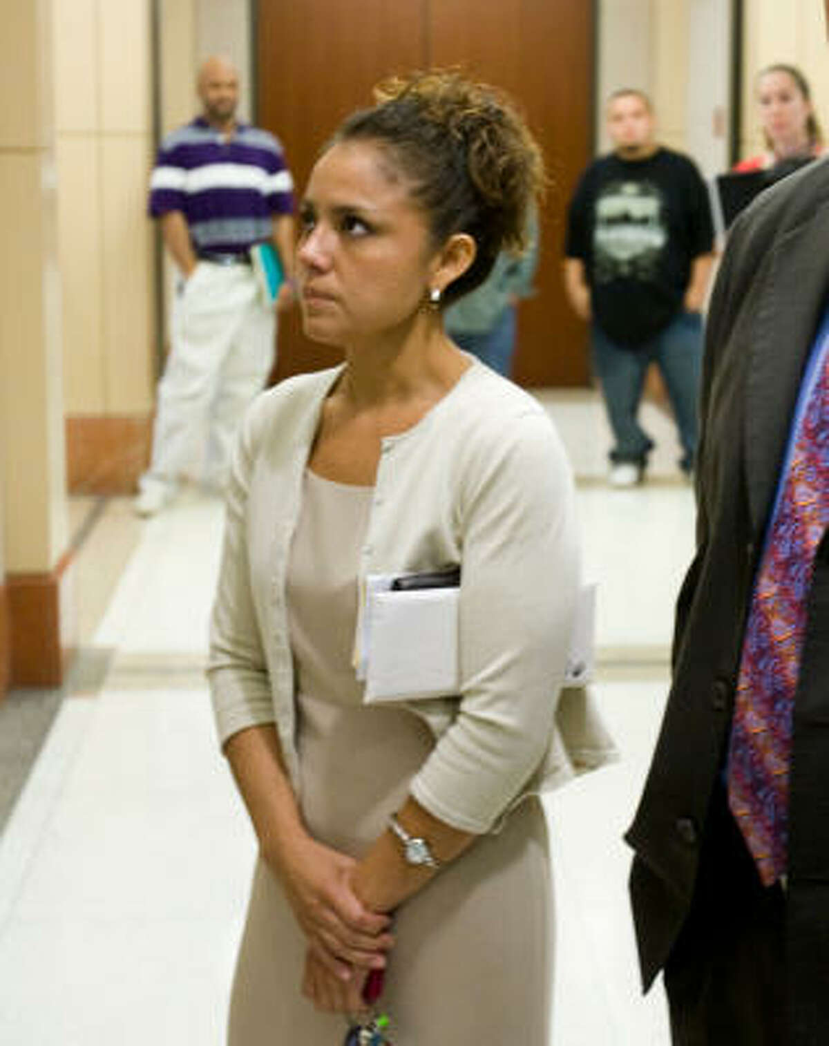 Virginia Cammack waits for an elevator after her court appearance today.