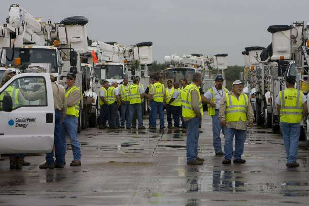 Crews from CenterPoint Energy gather in Rosenberg before heading to South Texas to help with storm repairs.