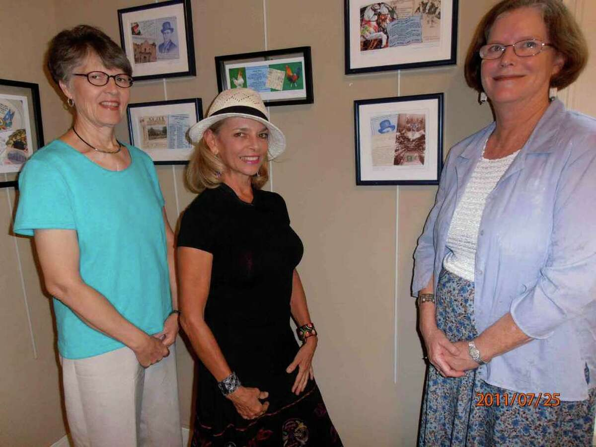 """Sharon Wallace (from left) and Kathleen Trenchard view """"Postcards From San Antonio"""" collages with their creator, Gayle Spencer, at the King William Association office."""