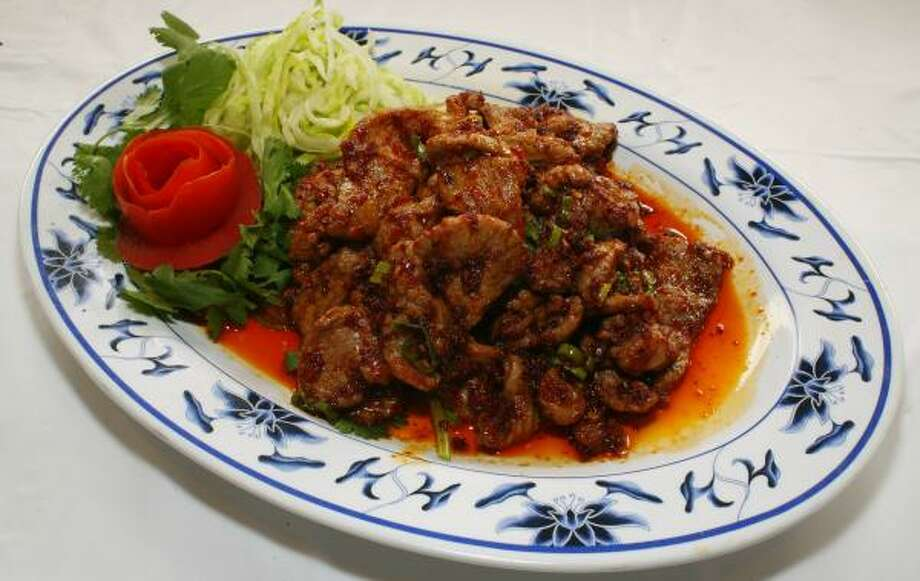 Sichuan's homestyle lamb slices served with leek flaps and julienned celery has made at least one diner weep, but were they tears of joy or was it the heat from the red chile pods that adorn the entree? Photo: Steve Ueckert, Chronicle