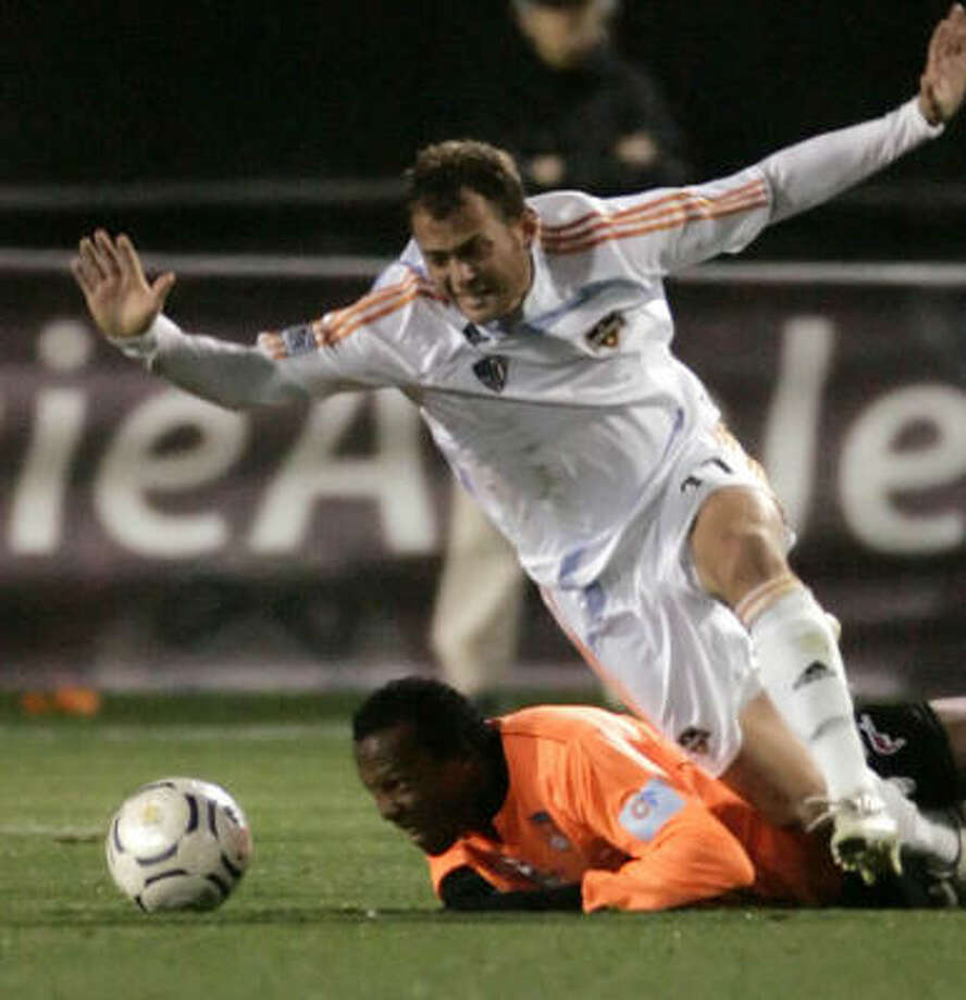 Brad Davis (shown in white against Puntarenas at College Station) had been expected to be an important part of the plan for games in the Dynamo's busy July schedule. Photo: BRETT COOMER, CHRONICLE