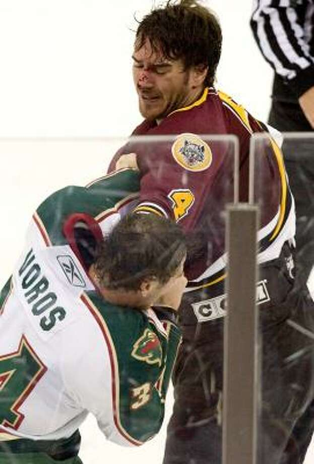 A bloodied Boris Valabik, right, shows little respect for the Aeros' Aaron Voros during a second-period scuffle. Photo: BOB LEVEY, FOR THE CHRONICLE