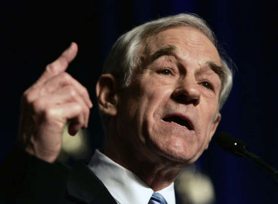 Ron Paul has been brought to prominence by his long-standing opposition to the nation's monetary system and the Federal Reserve Board that prints money and controls its supply. Photo: Evan Vucci, AP