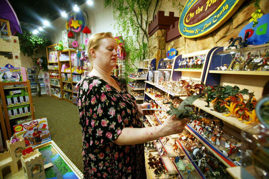 Carol Allred shops for toys for her son, Jodie, who is receiving taxpayer-funded private schooling after she waged a prolonged battle. Photo: Steve Campbell, Chronicle