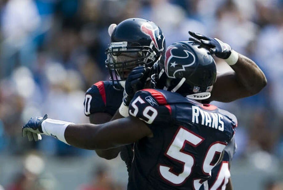 Houston Texans defensive end Mario Williams (90) and linebacker DeMeco Ryans (59) were both named All-Pro second-teamers Photo: Smiley N. Pool, Houston Chronicle