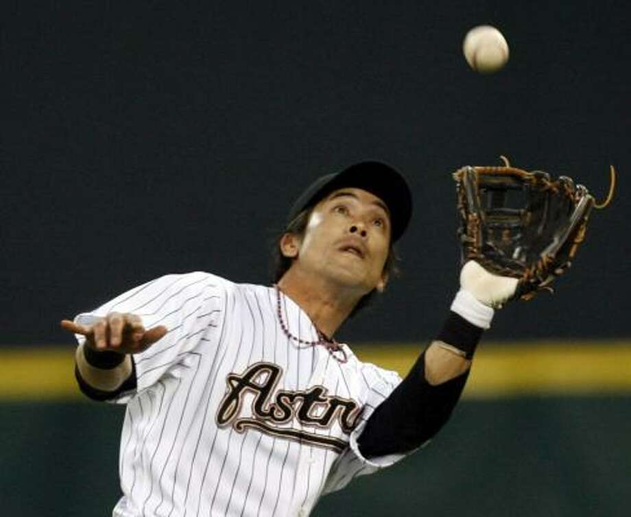 Kaz Matsui made his long-awaited Astros debut Friday, catching a pop up in the third inning of Friday's night's game against the Rockies. Photo: JOHNNY HANSON, CHRONICLE