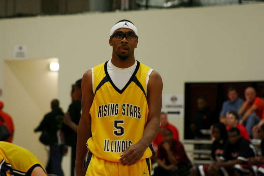 Marcus Jordan, a 6-foot-3 guard/forward for the Chicago's Rising Stars and youngest son of NBA legend Michael Jordan, in action at the Houston Kingwood Classic on Saturday. Photo: Gerald James, For The Chronicle