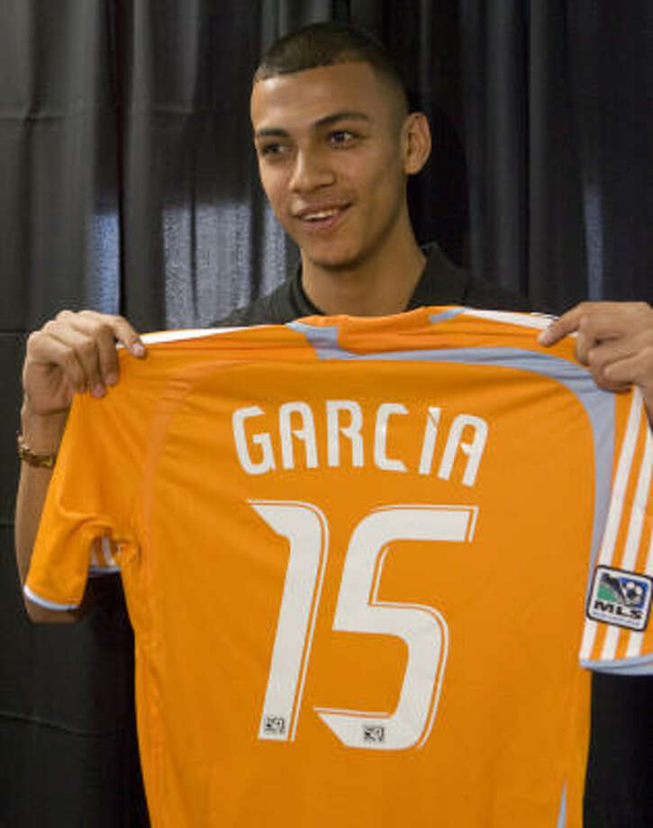 Felix Garcia holds up his new jersey as the Dynamo announced the signing of the 18-year-old forward on Thursday. Photo: Steve Campbell, Houston Chronicle