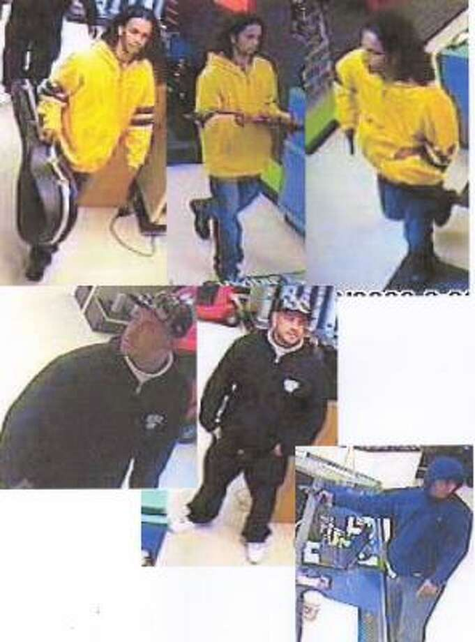 Security camera photos show the men during the recent robbery of a Houston pawn shop. Photo: Houston Police Department
