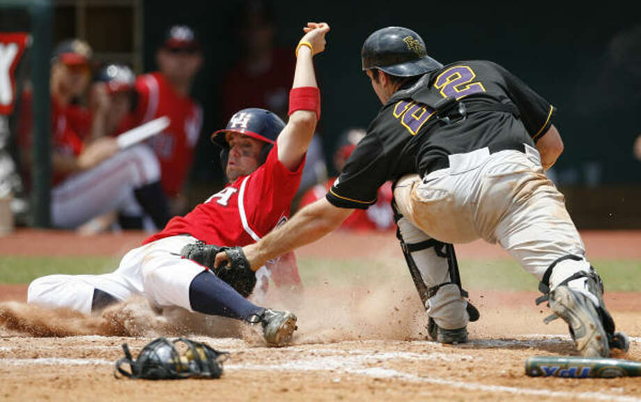 UH's David Murphy is called out at home on a tag by East Carolina catcher Jared Achen in the thirrd inning. Photo: Karen Warren, Chronicle