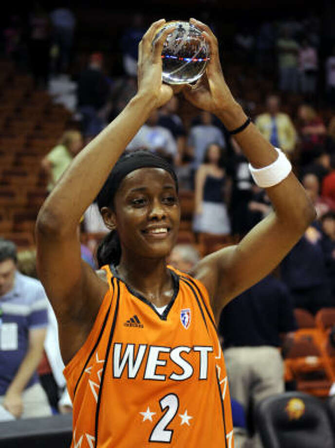 The Seattle Storm's Swin Cash holds up her MVP trophy after the end of the WNBA All-Star game in Uncasville, Conn. Photo: Bob Child, AP