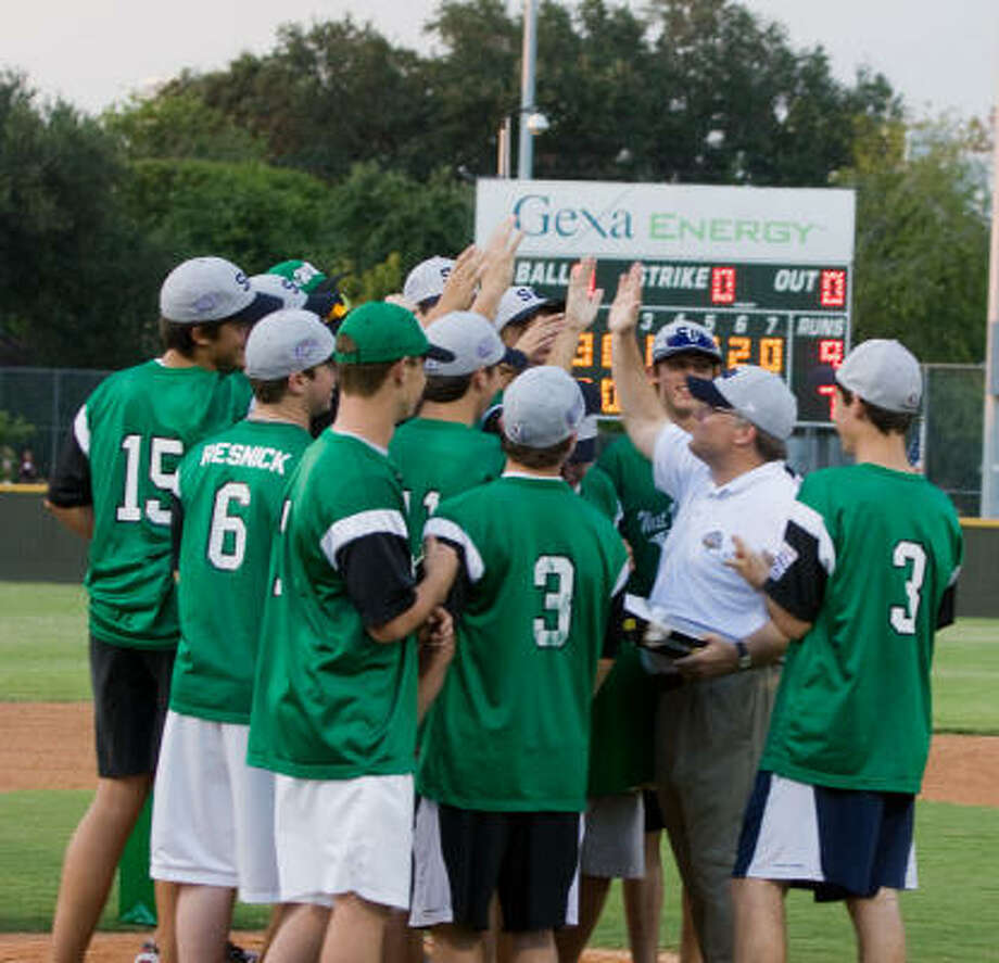 Bob McLamb, right, director of the West University Place Little League's Junior/Senior division, exchanges high 5's, with members of West U.'s  2009 World Series team. Photo: R. Clayton McKee, For The Chronicle