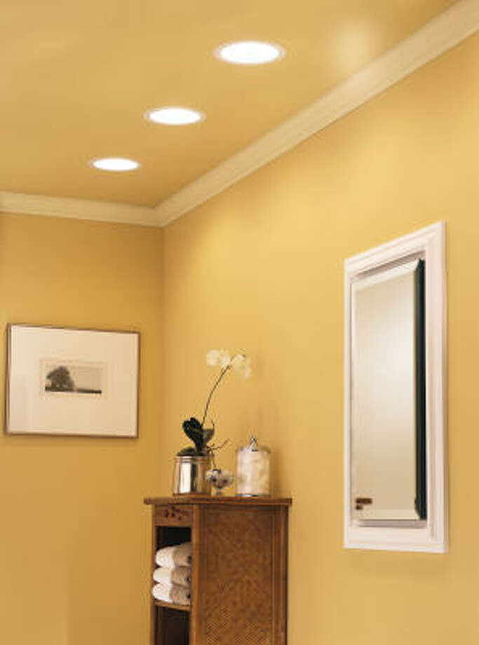 DOUBLE DUTY: This is a series of three combination recessed light/vent fans installed in one end of a large bathroom.