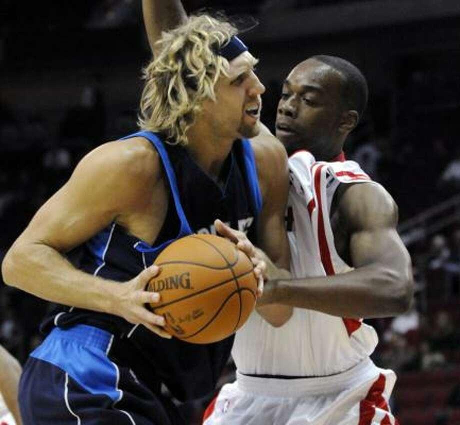 Rockets forward Carl Landry, right, had a team-high 22 points in Friday's loss to the Dallas Mavericks. Photo: Pat Sullivan, AP