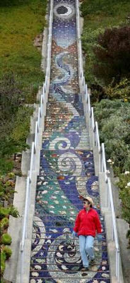 Edda Sydow walks down the mosaic staircase near Golden Gate Heights in San Francisco. Photo: Jeff Chiu, Associated Press