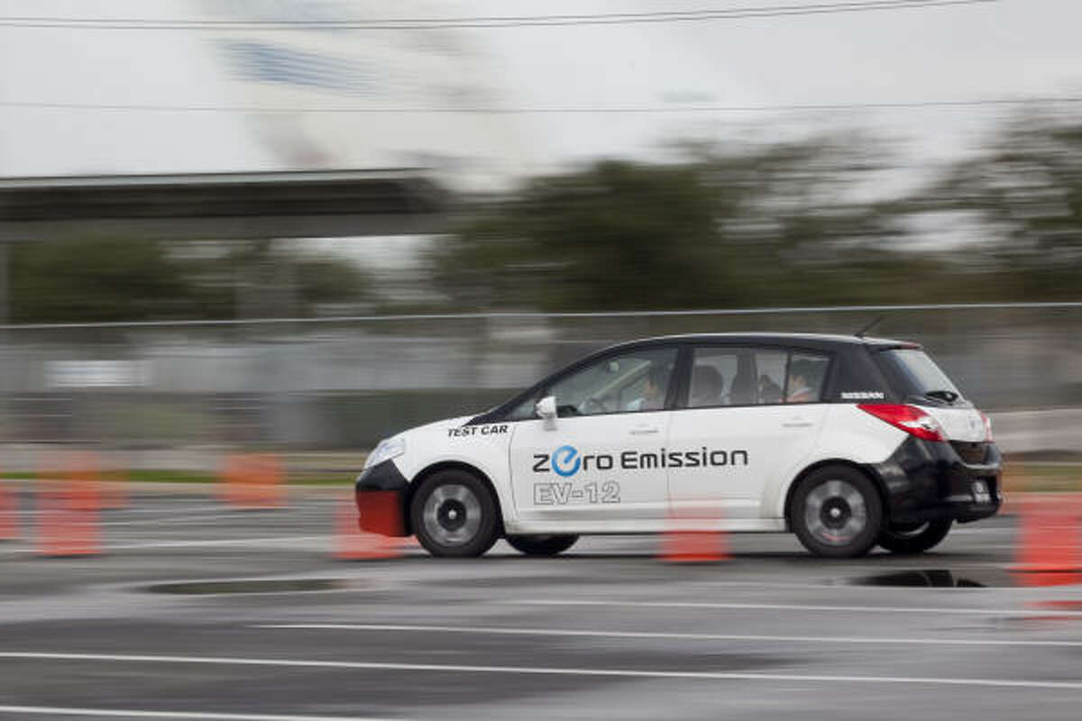 Nissan and Reliant Energy demonstrate the automaker's Leaf electric car Friday morning at Reliant Park.
