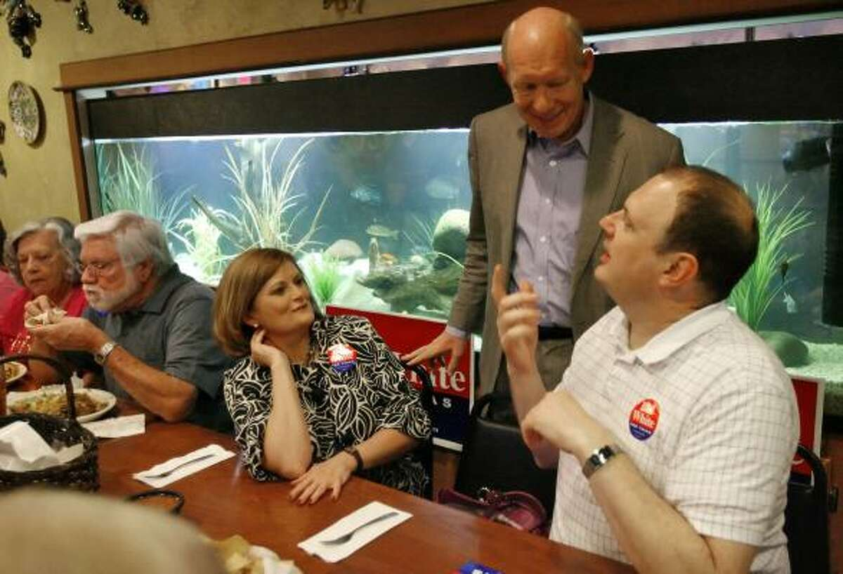 Democratic gubernatorial candidate Bill White, standing, talks with Johnnie Jones, center, and Steven Gates on Friday during a meet and greet at a restaurant in Odessa.