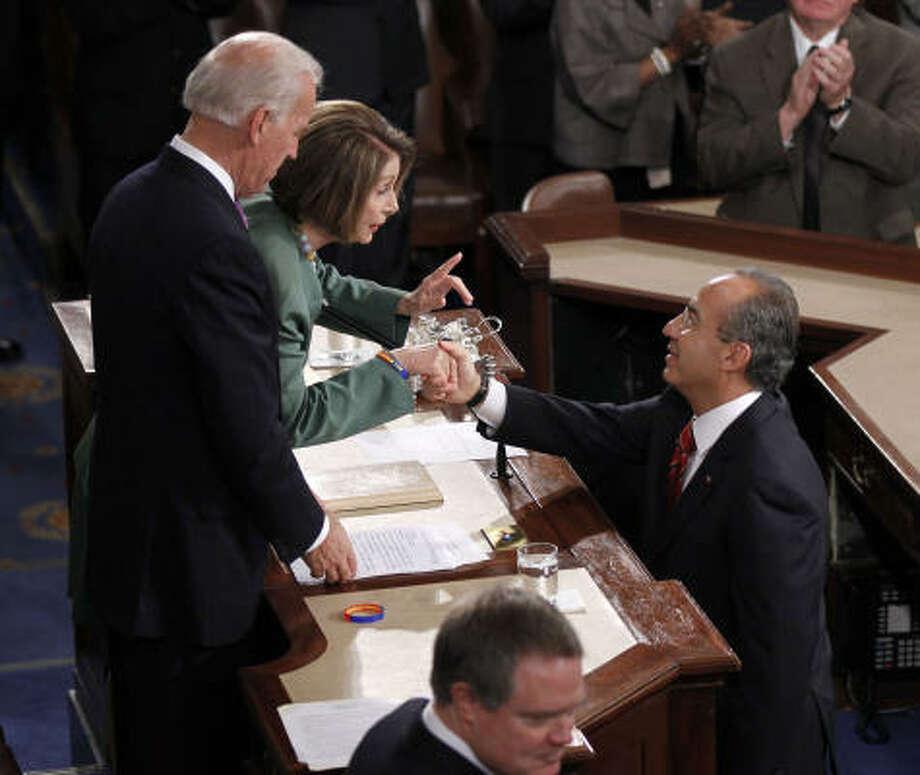 Vice President Joe Biden and Speaker Nancy Pelosi greet Mexican President Felipe Calderón before his address. Photo: Pablo Martinez Monsivais, AP