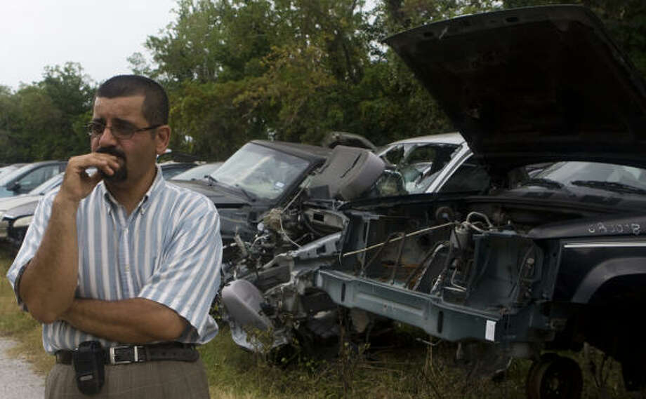 Salvage yard owner Cameron Tavakoli says the county's new regulations amount to a backdoor way of imposing zoning on a single industry. He said area salvagers are reviving an association through which they plan to hire a lawyer and a lobbyist. Photo: Yasmeen Smalley, Chronicle