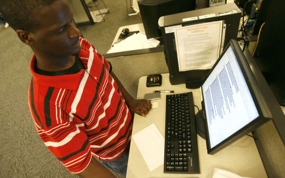 Gary White looks up potential openings this week at Workforce Solutions on Stella Link. Photo: Karen Warren, Chronicle